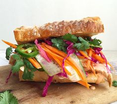 This bahn mi is ba-omb. Get the recipe: Grilled Banh-Mi with Pickled Vegetables and Sriracha Mayo   - Delish.com