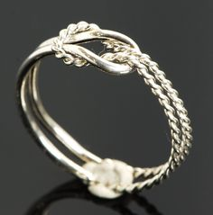 Infinity Knot Ring - love the two different textures For Brooke? Jewelry Knots, Cute Jewelry, Jewelry Box, Jewelery, Silver Jewelry, Jewelry Accessories, Jewelry Making, Infinity Knot Ring, Love Knot Ring