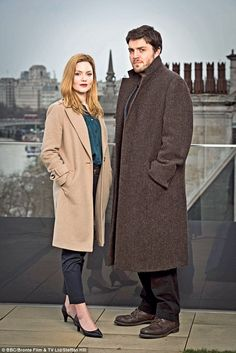 Cormoran Strike is played by Tom Burke, 36, who starred in BBC1's War And Peace. He's pictured with Holliday Grainger, who plays his future business partner RobinEllacott
