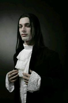 A sexy vampire ! Long hair, dark and wild , some blood  and attitude