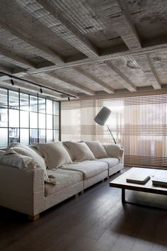 Faliro loft by Esé Studio. a rich combination of different textures, with wood Shoji screen type window treatment