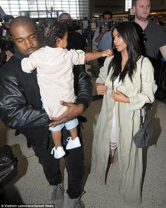 Hard to please: But it seems the tot wanted her mother as she reached out to Kim