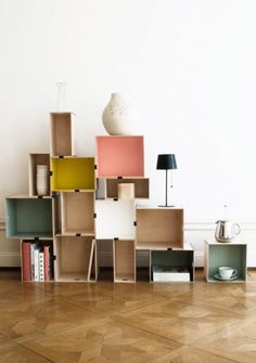 DIY colour block shelves made using boxes and bulldog clips - so clever, pretty and also easy to move/re-assemble.