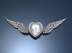 BLISTER PEARL AND DIAMOND BROOCH, LATE 19TH CENTURY. Designed as a winged heart, set throughout with circular-cut diamonds and decorated at the centre with a blister pearl weighing 9.09 carats, detachable brooch fitting.