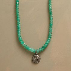"""CENTAURI EMERALD NECKLACE--A diamond pendant emerald necklace, in which sparkling green emeralds uphold a galaxy of diamonds embedded in sterling silver. Lobster clasp. A Sundance exclusive. 18-1/2""""L."""