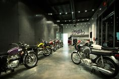 Champions Moto's vintage motorcycles on display in the front walkway of the shop.