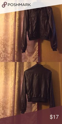 Brown Leather Jacket Size Medium.. Bought from Macy's.. Perfect Condition.. Zips up.. Has two front pockets Macy's Jackets & Coats