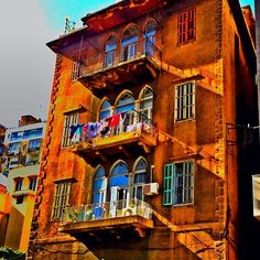 LOVE the old Levantine architecture with the arcades and the wrought iron- Beirut, Lebanon
