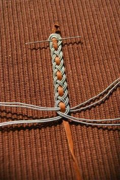 Silver wire braided around deerskin thong.  karkötő v. öv is lehet belőle