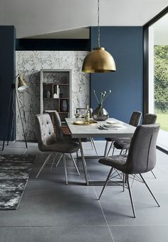 Retro inspired design meets contemporary style with our Halmstad Table & Hix Chairs, combining a cool grey concrete effect top with pearl grey leather and silver metal legs.