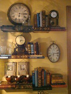 Clocks on shelves made of books