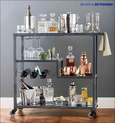 Short on counter space for holiday get-togethers? Roll in this bar cart for an instant and fun space-saving solution. It's the most stylish and functional way to display all of your party drinks, glassware and hors d'oeuvres.:
