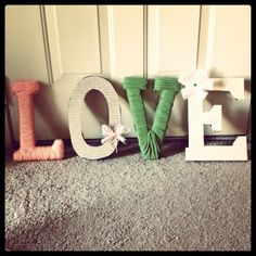 Cardboard letters wrapped in different materials.