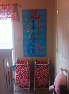 Lizzie-themed nursery for baby Lilly. Mommy Chelsey D. used the Lizzie baby bedding set and accessories, like these two hampers!