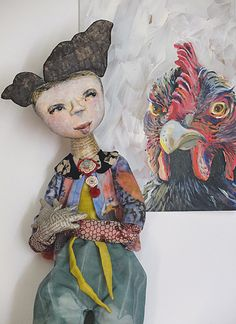 Artist: Barbara Mitchell -  Mother- in Law management!    Media: Acrylic paints, cardboard, cotton fabric, wool, news print paper mache.