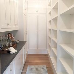 Loving all the storage in this pretty and practical pantry from our #midwayfarmhouse project.