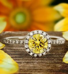 A gorgeous halo engagement ring set with a yellow diamond.