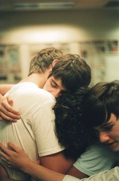 Sirius, James and Peter hug Remus at the platform before the summer holidays - 1977