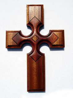 The star represents the light of Christ reaching the four corners of the world. Made from one solid piece of quarter sawn Sapele. Sapele is similar to Mahogany but much heavier and will cure to a dark brown rather than a red. Each star is engraved by hand. The star is finished in Velvit Oil (Mahogany).   Measures 11.25 H x7.5 W