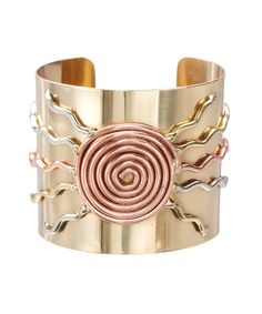Take a look at this Copper & Goldtone Leo Cuff today!
