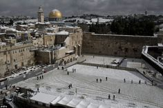 Icy blast: The Western Wall compound in the Old City of Jerusalem, Israel, today was covered with snow as temperatures plunge below zero