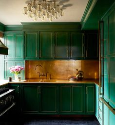 green cabinets <3  (also that chandelier is kick ass.)