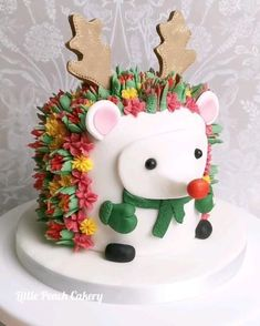 Hedgehog cake with rudolph nose and antlers. Buttercream flowers for spikes. Tutorial for hedgehog cake on link