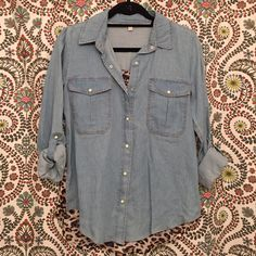 Gianni Bini Denim/Leopard Top NWOT Gianni Bini denim top with leopard print detail on back!! SO ADORABLE, it just doesn't coordinate with the rest of my closet!! Never worn, basically brand new condition!! Gianni Bini Tops Button Down Shirts