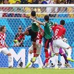 Rafael Marquez (2nd L) of Mexico scores