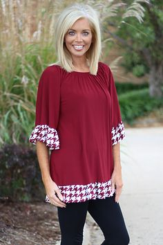 The Cutest Houndstooth Ruffled Tunic ~ Burgundy, $37.00 (http://www.onefaithboutique.com/new-arrivals/the-cutest-houndstooth-ruffled-tunic-burgundy/)