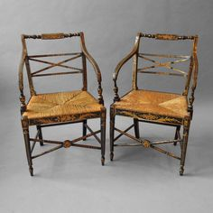 A Pair of Regency Ebonised and Gilt Penwork Open Armchairs. C 1810 England
