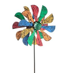 Fans of color twirl round and round in our Colorful Windmill Metal Spinner. Bladelike wind catchers with bold, metallic finishes accent this spinner's two rotors. When the wind picks up these two vibrant rotors will spin around an elegant green rotor hub, creating a flurry of motion and color. Stake this seven-foot tall windmill spinner near a porch, patio or outdoor living area and prepare to enjoy the breezy show!