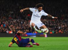 Marcelo of Real Madrid CF evades Xavi of Barcelona during the La Liga match between FC Barcelona and Real Madrid CF at Camp Nou on March 22, 2015 in Barcelona, Catalonia.