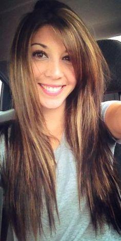 caramel highlights in her dark hair, unique & pretty