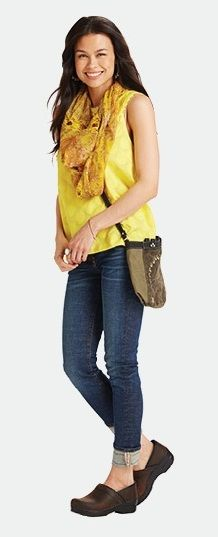 Dansko Clog styled with jeans and a bright top