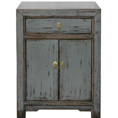 This gray side chest with two doors would be a great bedside chest in a colorful room.