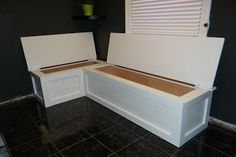 DIY Kitchen banquette. Paint round table with accent color and pair with rustic chairs.