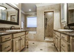 Spa like master bath // Dual vanities and a walk-in shower