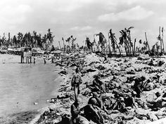 insooutso:    WWII November 1943, The Battle Of Tarawa. One of the bloodiest & most ferocious battles of WWII when the U.S Marines fought the Japanese on the small island nation of Kiribati in the Pacific. I have been fortunate enough to spend some time in Kiribati & stood on this very beach. A humbling & emotional experience.    Today, Tarawa is completely spoiled with pollution. It's really a sad sight to see. But at low tide, it's amazing to look out at the coral reef and s