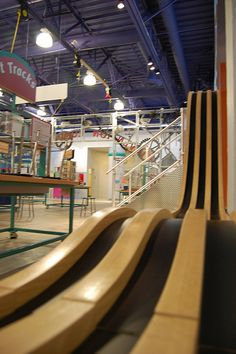 Race tracks at the Invension Convention, Children's Museum of Houston. Make cars out of Lego parts and send them down the track! how fast can you go? see them gain speed.