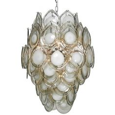 Diva Chandelier in Grey features blown glass discs surrounding a chrome interior. Dramatic and intriguing light fixture makes a statement in high entryway.