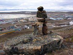 An inukshuk overlooking the community of Iqaluit, Nunavut, Canada.