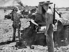 Marines of the 1st Marine Division in the Peleliu airfield standing next to smashed Japanese tanks Type 97 Ha-Go, Sept 1944.