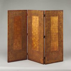 Three-paneled screen  Louis Comfort Tiffany (American, New York 1848–1933 New York) Date: 1910–15    Embossed Japanese leather paper, vermilion and gold leaf on wood frame Dimensions: 45 1/4 x 54 3/4 in