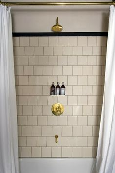 square tile instead of the traditional rectangle tile, laid in a subway pattern