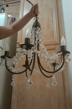 Diy chandelier makeover very clever thanks nancy diy diy chandelier ikea chandelier w crystals from micheals chandelier ikea painted out into different colors of course aloadofball Choice Image