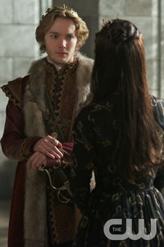 "Reign -- ""Tasting Revenge"" -- Image Number: RE216a_0105.jpg -- Pictured (L-R): Toby Regbo as King Francis II and Adelaide Kane as Mary, Queen of Scotland and France (back to camera) -- Photo: Sven Frenzel/The CW -- © 2015 The CW Network, LLC. All rights reservedpn"