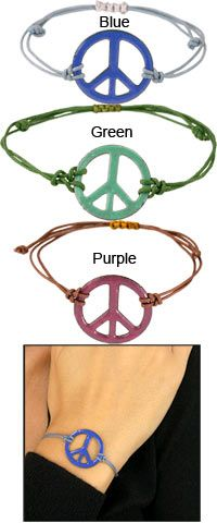 Handmade Copper & Enamel Peace Sign Bracelet at The Hunger Site these are awesome i bought mine for like 5.00 at a head shoppe.. :)