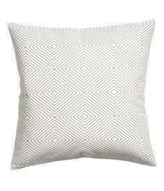 White. Cushion cover in slub-weave cotton fabric with a printed pattern. Concealed zip.