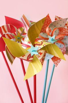 """a great blog """" a field journal """" with a ton of great diy projects for parties or weddings ... this post has a tutorial on how to make pinwheels and rolled paper flowers"""